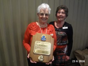 Lioness Fay Brooker holding her award presented by one of the founding Sutherland Shire Lioness members Helen Eastwood. Photographer Lynne Thorn.